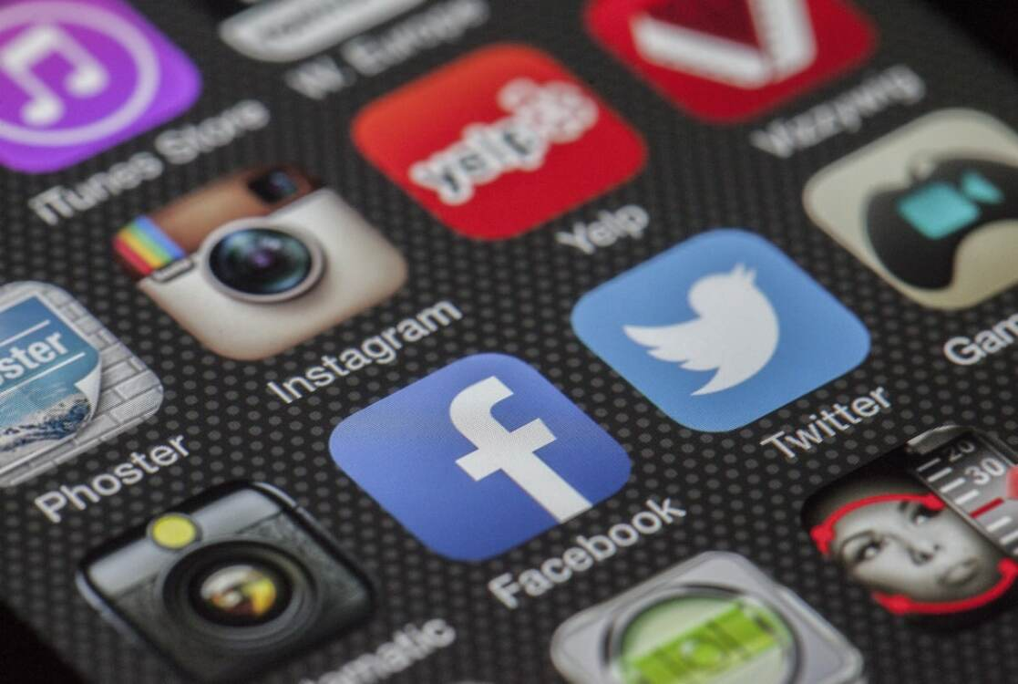 Social media apps displayed on mobile device screen | Social media services