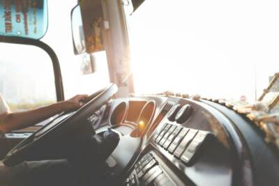 a paratransit drivers hand on the wheel