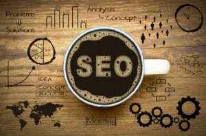 Full Coffee Cup with SEO Written on Coffee