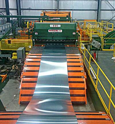 Front view of steel feeding into steel slitting line | Steel slitting line for sale